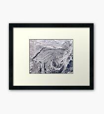 clouds over the ocean Framed Print