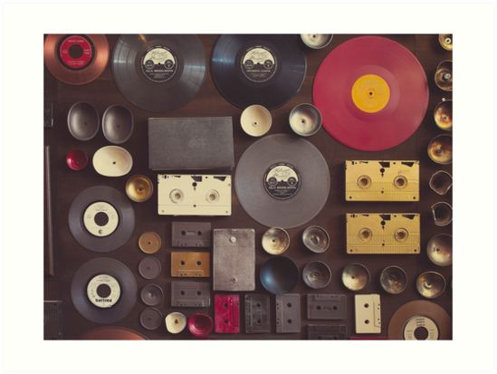 Vintage wall with vinyl records and audio cassettes hung. by Pino Esposito