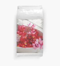 Red, pink and white flowers in a white cup Duvet Cover