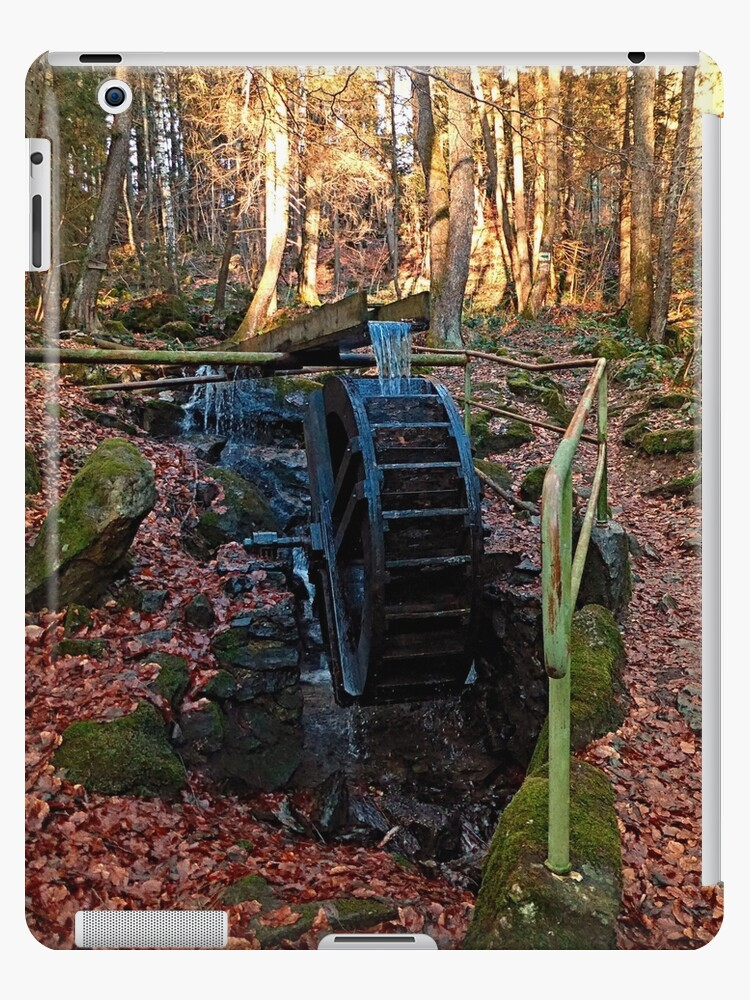 Water wheel in the wood | architectural photography by Patrick Jobst