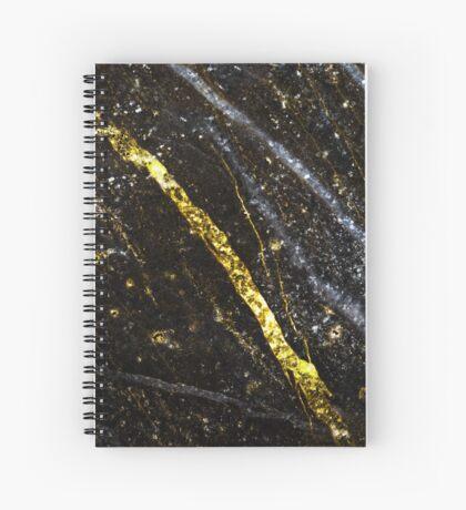 Gold sparkly line on black rock Spiral Notebook