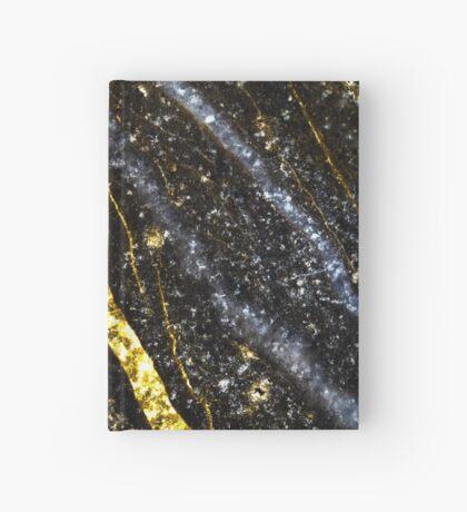 Gold sparkly line on black rock Hardcover Journal