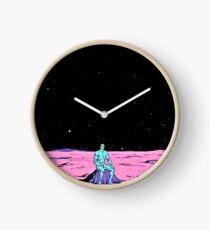Dr. Manhattan sitting on mars (comic) Clock