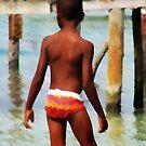 Boy on Dock by Gene  Tewksbury