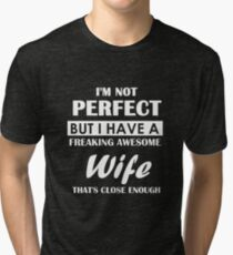 Not perfect, but the woman. Tri-blend T-Shirt