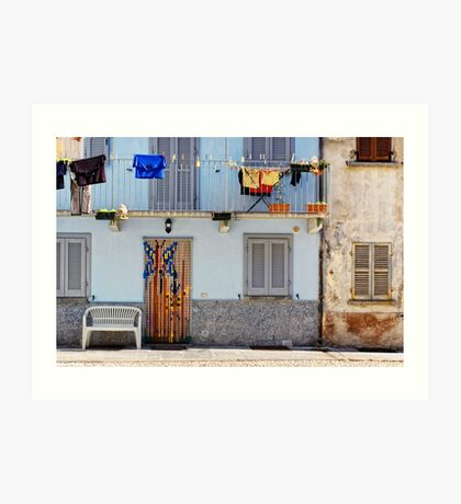Italian windows with hanging washing and bench Art Print