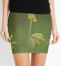 Cowslip blooming in a trio of Three Mini Skirt
