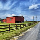 Red Barn On A Gravel Road by James Brotherton