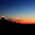 Lighthouse at morning twlight by kathy s gillentine