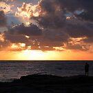 Lone fisherman at sunrise by myraj