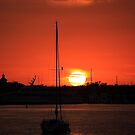 sunrise over Mantanaz Pass Harbor by kathy s gillentine