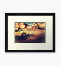 Taxi driving in the city Framed Print