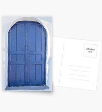 Blue door in Santorini Postcards