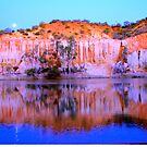 Golden limestone cliffs at sunset on the River Murray with a full moon rising by Vic Ratnieks