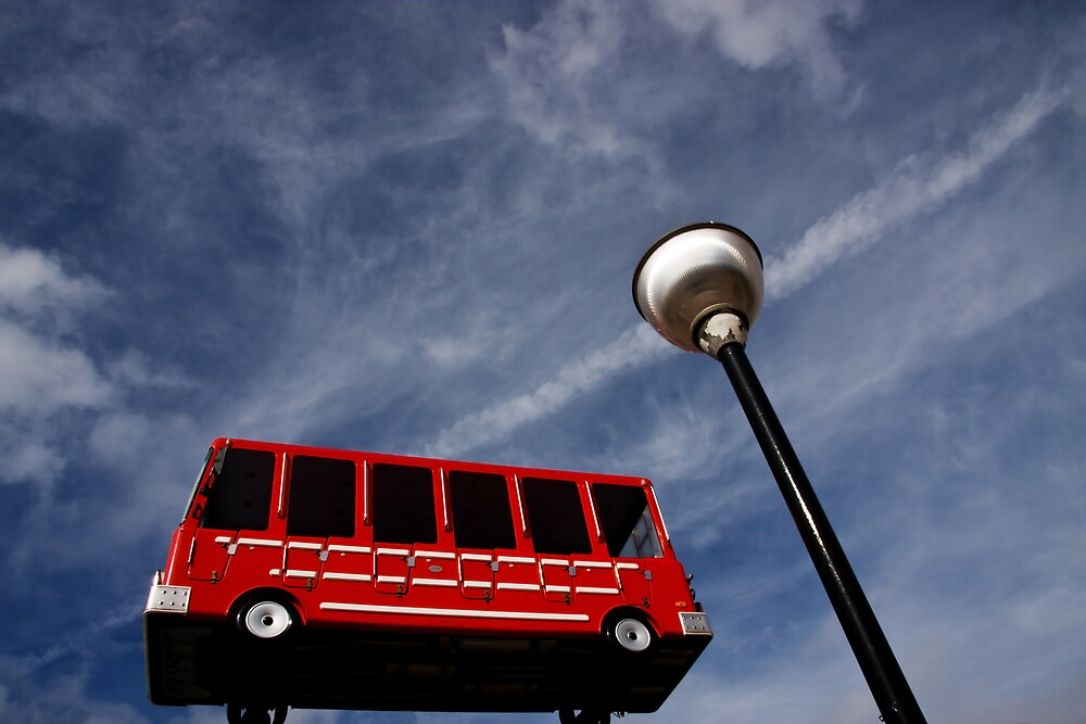 Big red bus by Mark E. Coward