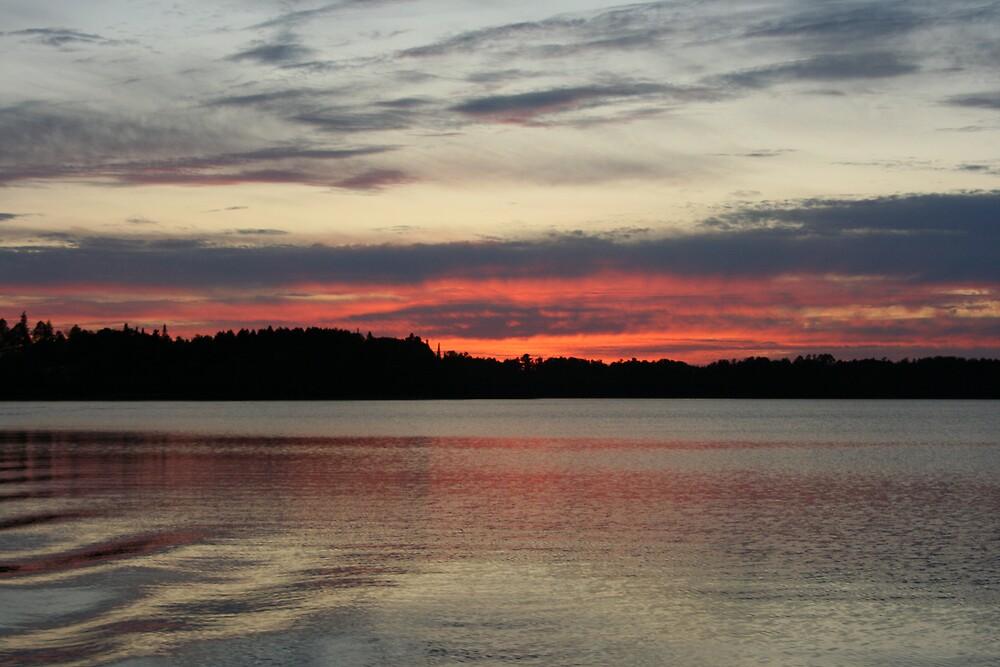 Sunset on Sand Lake by warmchocmilk