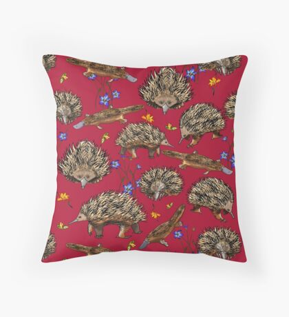 monotremes and wildflowers on cardinal Throw Pillow