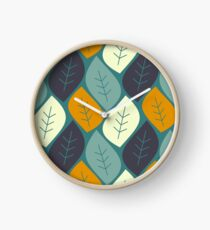 abstract colorful leaves on blue background pattern illustration Clock
