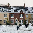 Building a snowman by Jon Tait