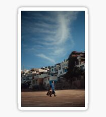 Man walking on the moroccan beach at sunrise in Taghazout Sticker