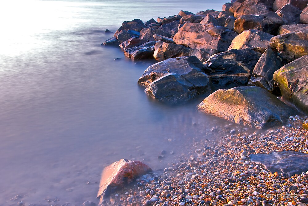 Rocks on the Beach in the early morning by IanJohnston