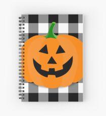 Orange Halloween Jack O' Lantern Pumpkin on Black and White Buffalo Check Spiral Notebook