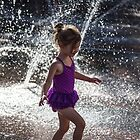 USA. Colorado. Denver. Little Girl Playing in the Fountain. by vadim19