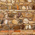 Brown Italian medieval stone wall by Chris Warham