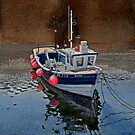 Fishing Boat in Staithes Harbour by Graham Clark