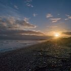 Sunrise on a Pebble Beach by Clare Colins
