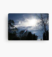 Sun Peeking Through Winter Clouds  Canvas Print