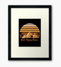 God's Playing Games Framed Print