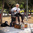Street musician by Riko2us