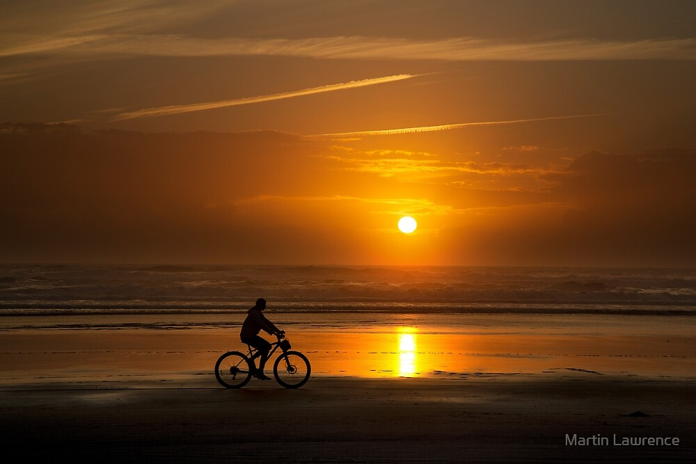 Silhouette of a cyclist along Cannon Beach Oregon by Martin Lawrence