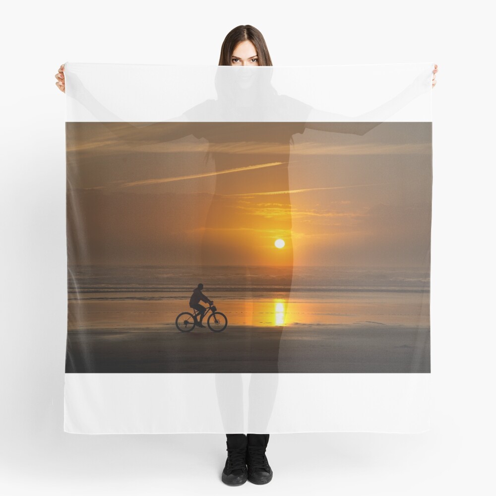 Silhouette of a cyclist along Cannon Beach Oregon Scarf