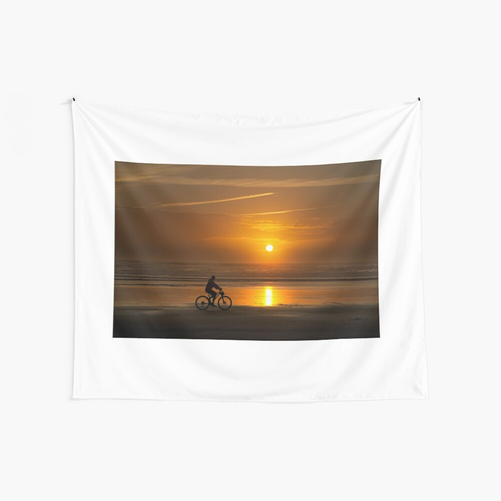 Silhouette of a cyclist along Cannon Beach Oregon Wall Tapestry