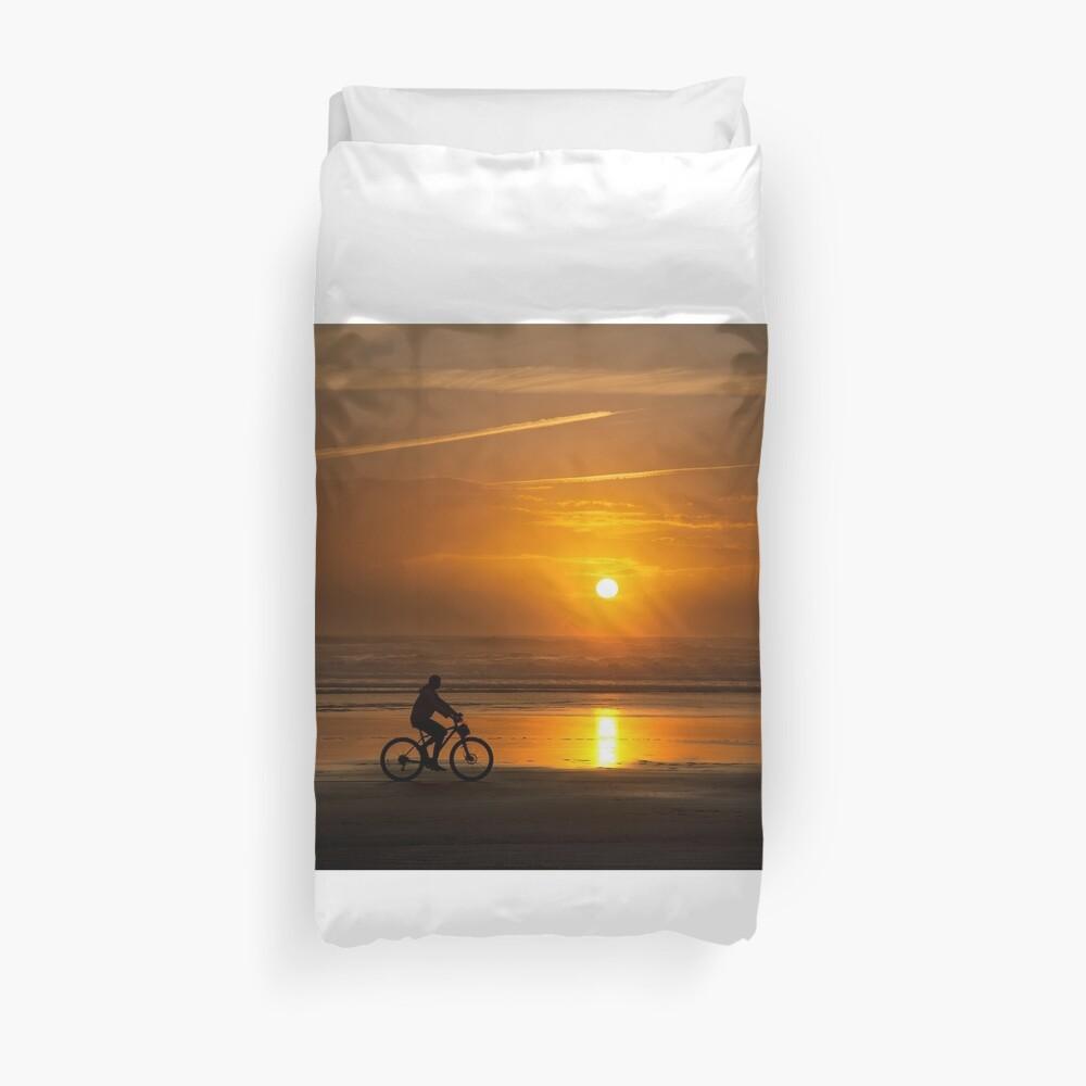 Silhouette of a cyclist along Cannon Beach Oregon Duvet Cover