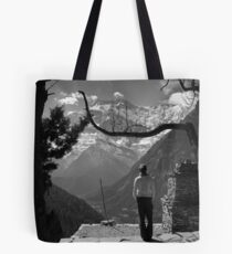Girl looking out over valley and mountain Tote Bag