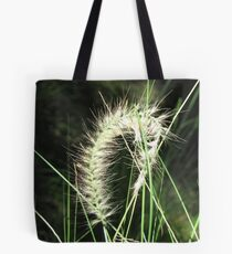 Sunlit grass flower Tote Bag
