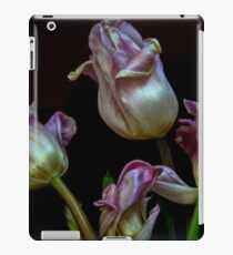 close up of a Wilted red Tulip on a stem iPad Case/Skin
