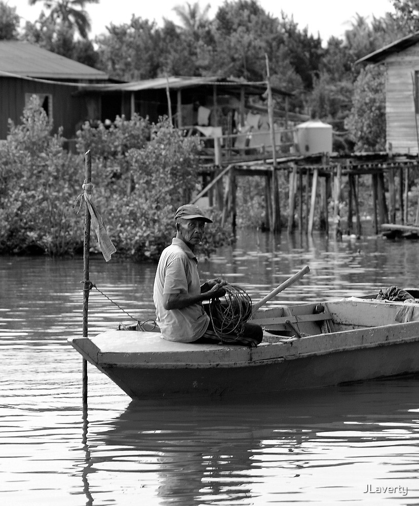 Malaysia: Fisherman in his boat by JLaverty