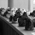 Dog Statues. by Sharon Brady