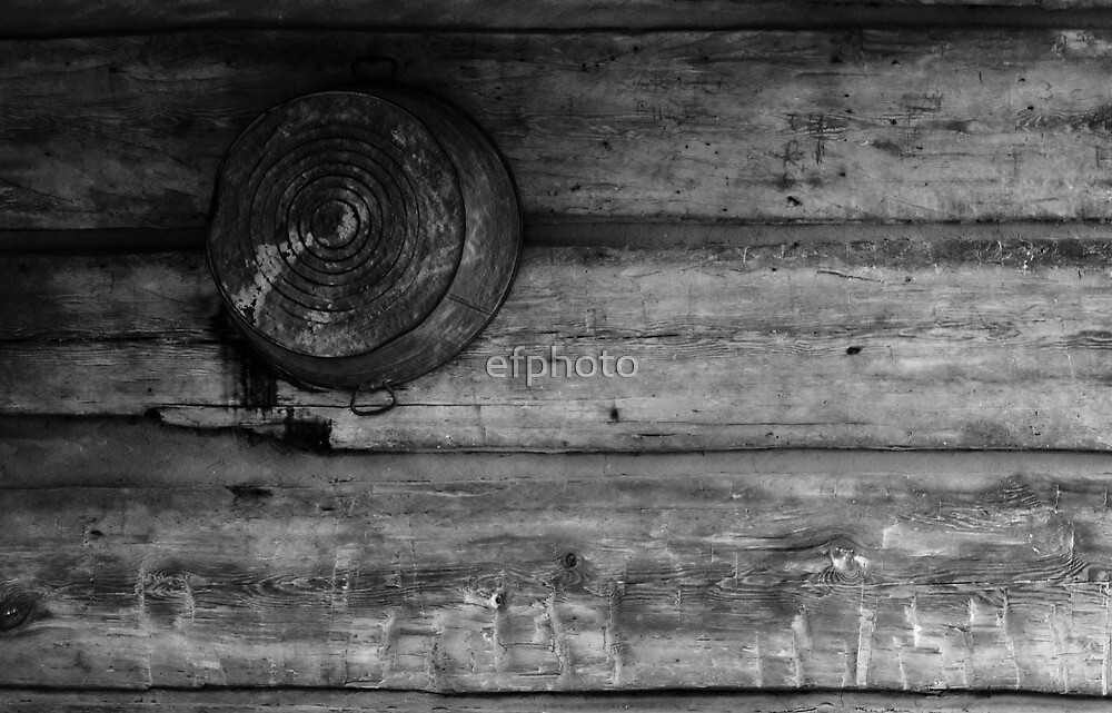Bucket hanging from wall. by efphoto