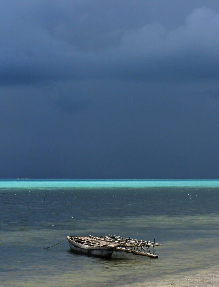 Canoe at Kimuta by Reef Ecoimages