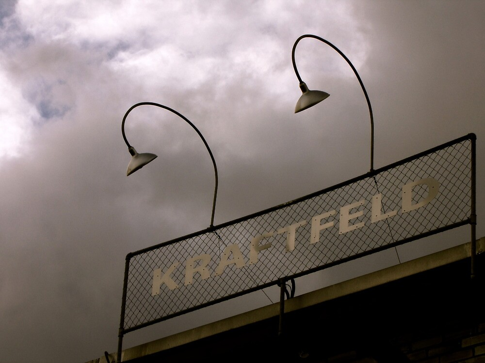 Kraftfeld - Silver sign on a grey sky by Christian Langenegger