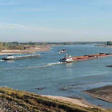 Nijmegen Gelderland The Netherlands View from Waalbrug across the River Waal at Nijmegen, with freight ships ploughing along the river.  by stuwdamdorp