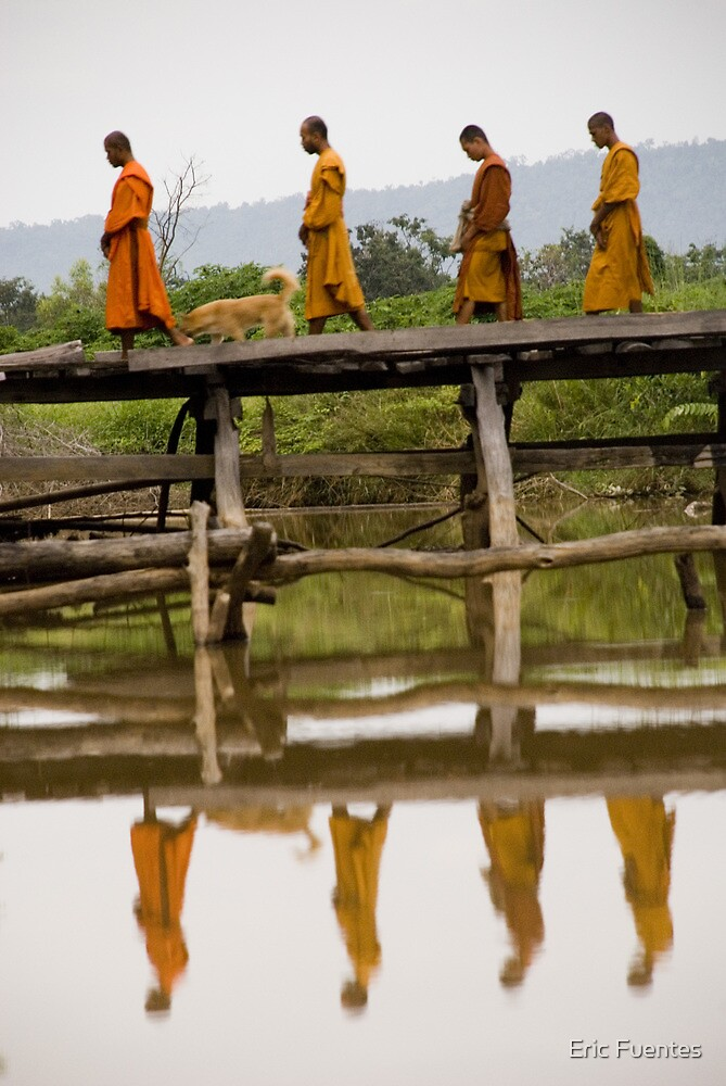 8 monks on bridge by Eric Fuentes