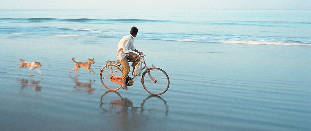 Bike on the beach in Goa by violetstar