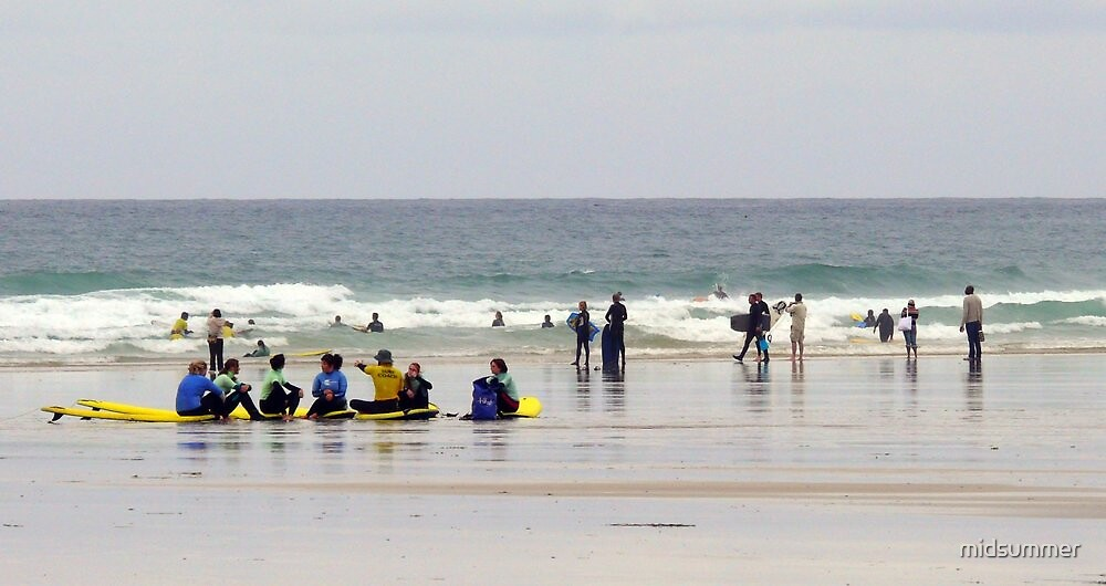 Surfers at Gwithian by midsummer