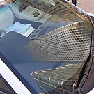 Canary Wharf reflected in the windscreen of a Lamborghini by Terry Senior